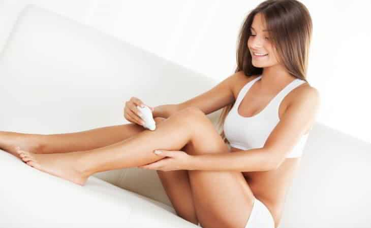 Woman Using Epilator
